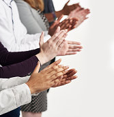 Shot of a group of people clapping their hands together