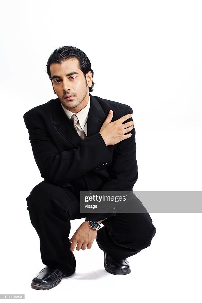 A well dressed businessman sitting : Stock Photo