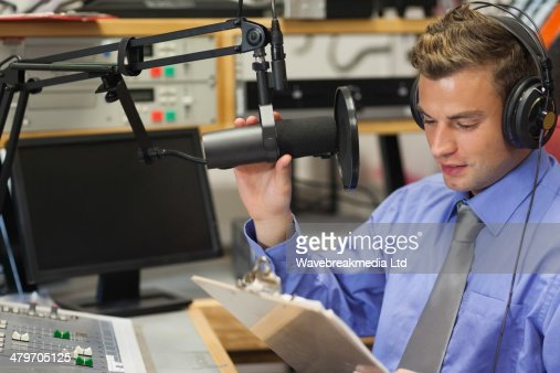 Well dressed focused radio host moderating : Stock Photo