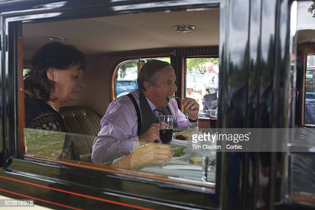 Well dressed racegoers eat a meal in their vintage car at the Royal Ascot After over a decade of Labour Government in Great Britain the gap between...
