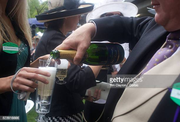 Well dressed racegoers pour champagne during the Royal Ascot race meeting After over a decade of Labour Government in Great Britain the gap between...