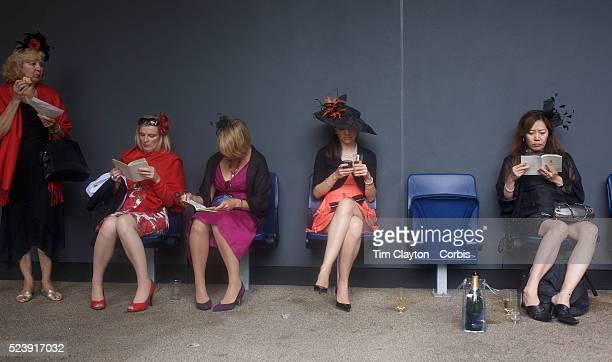 Well dressed racegoers read race programs and check their mobile phones at the Royal Ascot After over a decade of Labour Government in Great Britain...