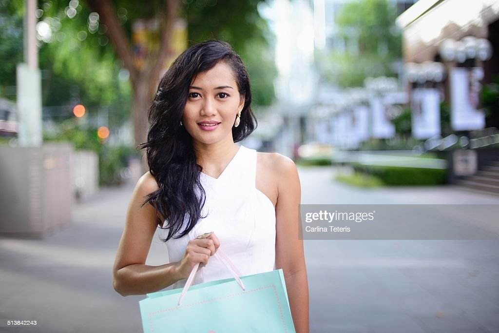Well dressed woman holding a shopping bag