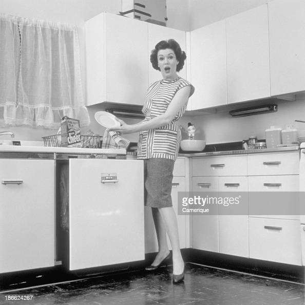 Woman In The Kitchen Dishwasher Pictures | Getty Images
