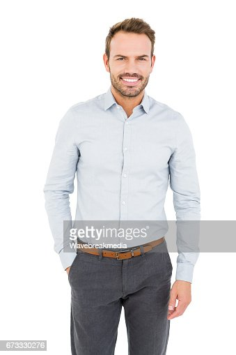 Well dressed young man smiling at camera : Stock Photo