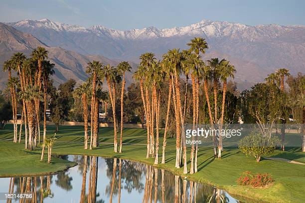 Well kept golf resort in the desert with mountain background