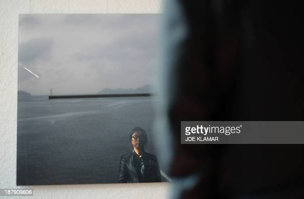 Well known South Korean art photographer Kim Woo Young is reflected in his photograph of Japan's Naoshima during the last preparations for his...