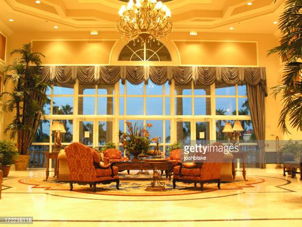Well lit hotel lobby with nice furniture