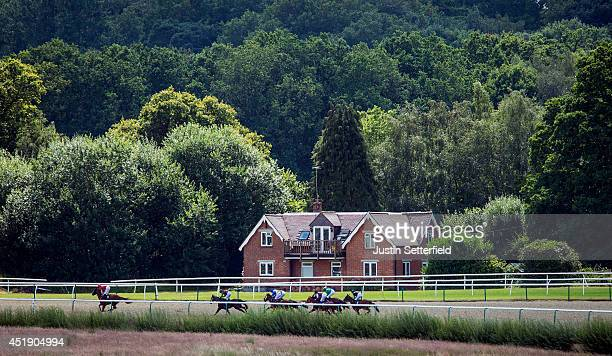 Well Painted riden by Robert Tart leads the field in the 32Red Selling Stakes at Lingfield Park on July 9 2014 in Lingfield England