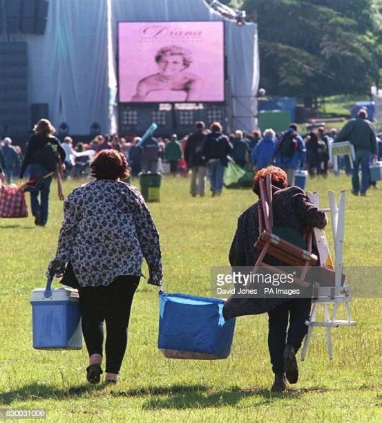 A well supplied duo arriving with the crowds for last night's tribute concert to Diana Princess of Wales at Althorp in Northamptonshire Picture DAVID...