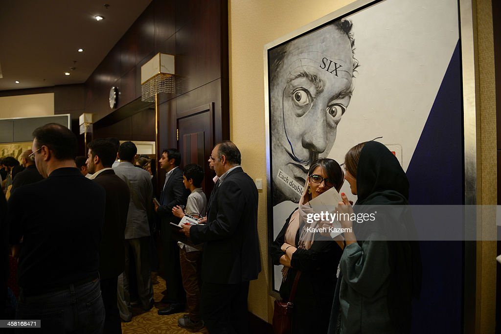 Well to do Tehranis attend a contemporary art auction by famous Iranian artists in the dinning hall of hotel Azadi on June 28, 2013 in Tehran, Iran.