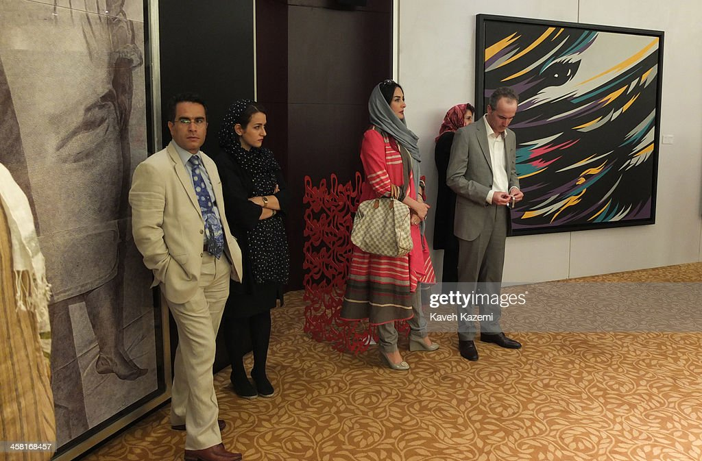 Well to do uptown Tehranis in modern clothing attend a contemporary art auction by famous Iranian artists in the dinning hall of hotel Azadi on June 28, 2013 in Tehran, Iran.