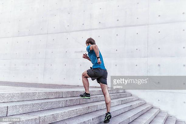 well trained sportsman running up stone stairway