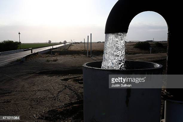 Well water is pumped from the ground on April 24 2015 in Tulare California As California enters its fourth year of severe drought farmers in the...