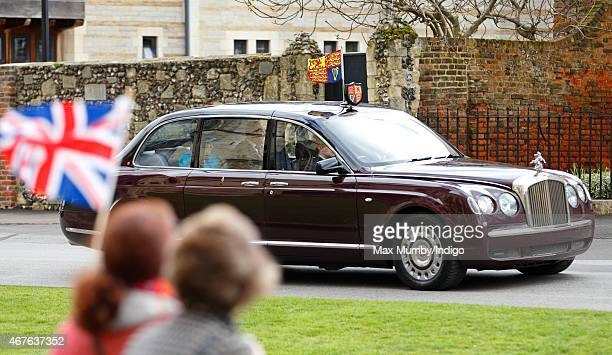 A well wisher waves a Union Flag as Queen Elizabeth II and Prince Philip Duke of Edinburgh visit Canterbury Cathedral where The Queen unveiled a...