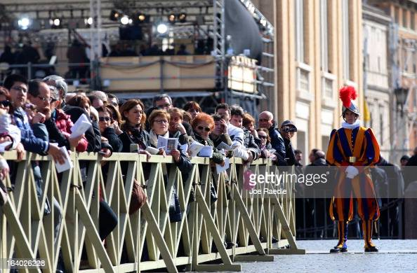 Well wishers attend the Inauguration Mass for Pope Francis in St Peter's Square on March 19 2013 in Vatican City Vatican The mass is being held in...