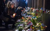 Well wishers bring flowers and light candles to honour the shooting victims outside the main Synagogue in Copenhagen Denmark on February 15 2015 Two...