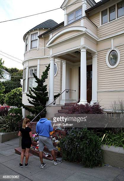 Well wishers gather in front of the home where actor and comedian Robin Williams filmed the movie Mrs Doubtfire on August 12 2014 in San Francisco...