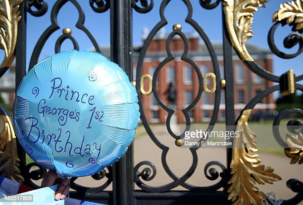 Well wishers place baloons and flags outside Kensington Palace as Prince George of Cambridge turns 1 on July 22 2014 in London England Prince George...