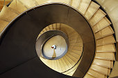 Wellcome Collection staff member Emily Pritchard poses on a new spiral staircase on February 12 2015 in London England The staircase is part of a...