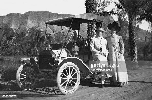 Elegant Looking Couple By Their Period Ford Automobile Ca