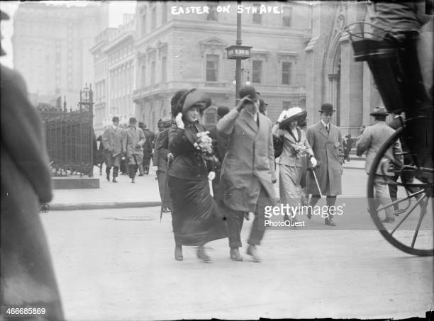Welldressed couples promenade on a blustery Easter Sunday on Fifth Avenue at 50th Street New York New York early 1910s