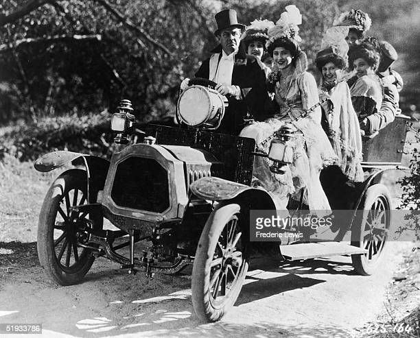 A welldressed gentleman takes a group of smiling ladies for a drive in the country circa 1900