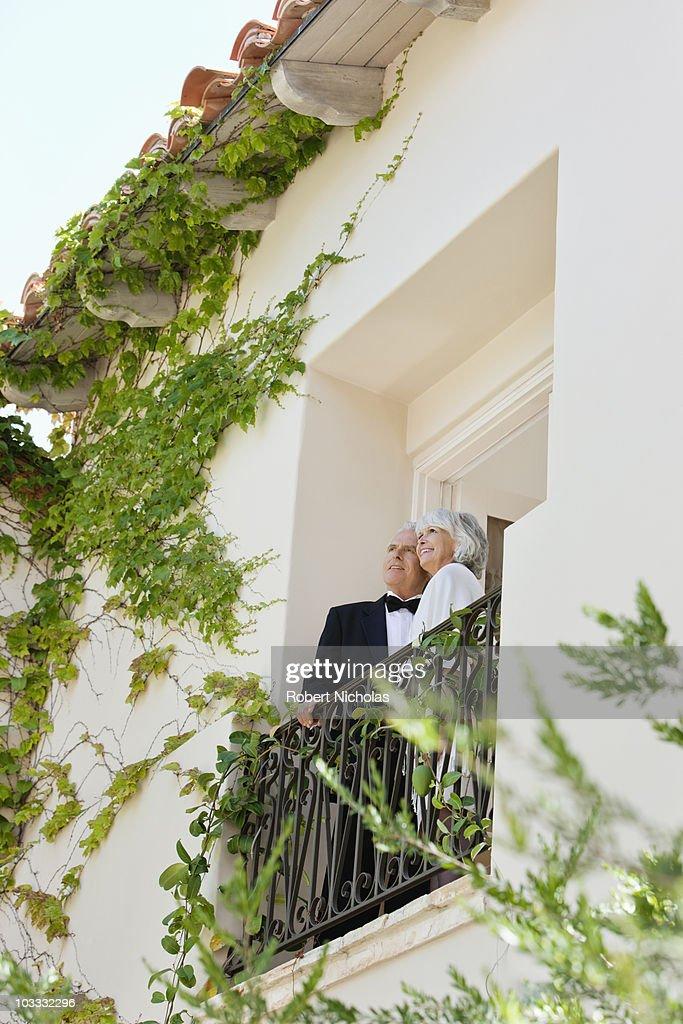 Well-dressed senior couple on balcony : Stock Photo