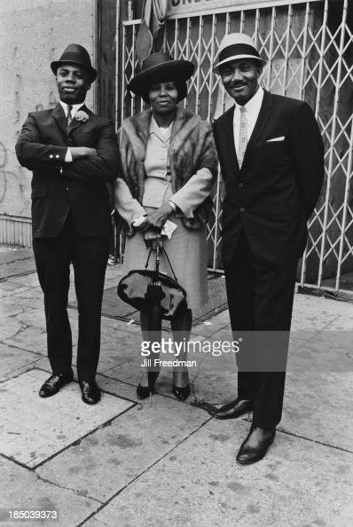 A welldressed woman and two men pose for a picture on a street in Newark New Jersey May 1968