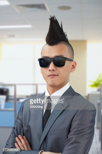 Well-dressed young man with Mohawk and sunglasses
