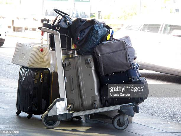 Well-filled luggage trolley at airport