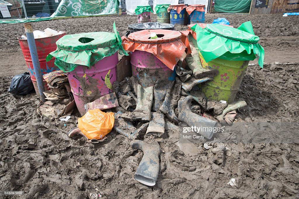 Wellies are left discarded as festival goers leave the Glastonbury Festival 2016 at Worthy Farm, Pilton on June 26, 2016 near Glastonbury, England. The Festival, which Michael Eavis started in 1970 when several hundred hippies paid just £1, now attracts more than 175,000 people.