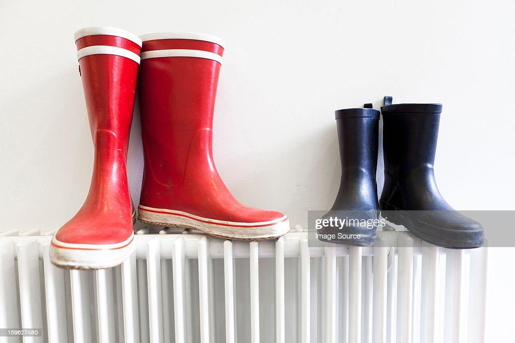 Wellington boots on radiator