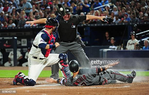 Wellington Castillo of the Arizona Diamondbacks scores a sixth inning run against A J Pierzynski of the Atlanta Braves at Turner Field on May 7 2016...