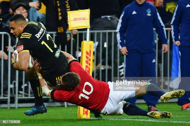 Wellington Hurricanes' Ngani Laumape scores a try as British and Irish Lions' Dan Biggar tackles him during the rugby union match between the...