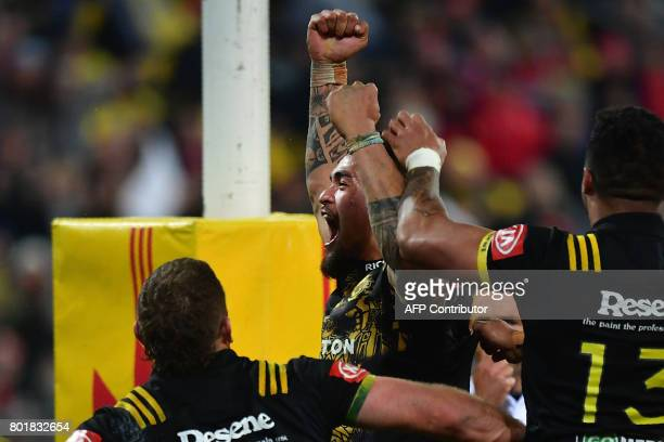 Wellington Hurricanes Vaea Fifita celebrates scoring a try against the British and Irish Lions during their rugby union match at Westpac Stadium in...