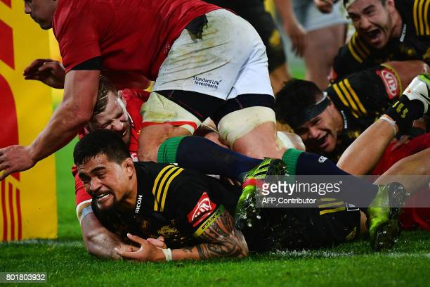Wellington Hurricanes Vaea Fifita scores a try against the British and Irish Lions during their rugby union match at Westpac Stadium in Wellington on...
