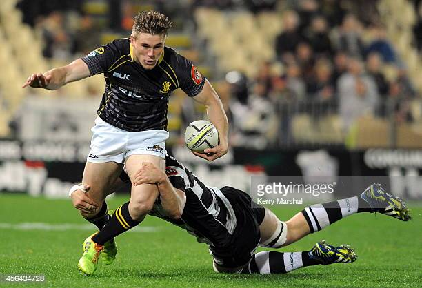 Wellington Jason Woodward is tackled by Hawkes Bay's Michael Allardice during the ITM Cup Ranfurly Shield rugby match between Hawkes Bay and...
