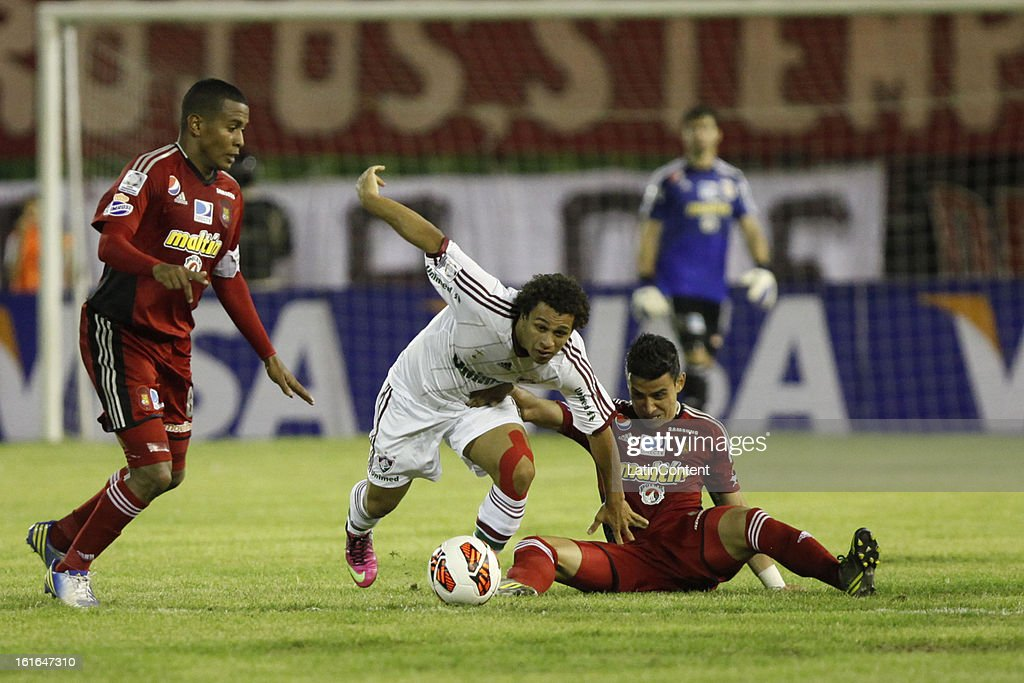 Wellington Nem Fluminense fights for the ball during a match between Caracas FC and Fluminense as part of the 2013 Copa Bridgestone Libertadores at the Olympic Stadium on February 13, 2013 in Caracas, Venezuela.