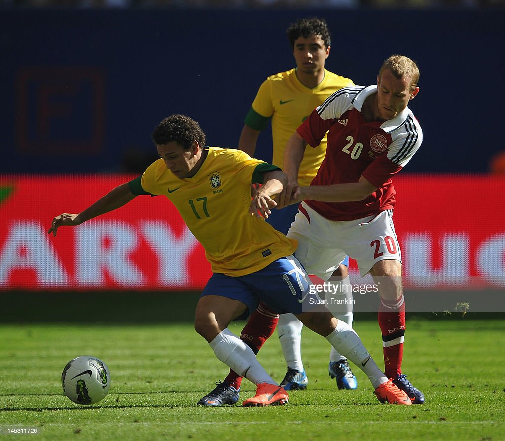 Wellington Nem of Brazil is challenged by Thomas Kahlenberg of Denmark during the International friendly match between Brazil and Denmark at the...