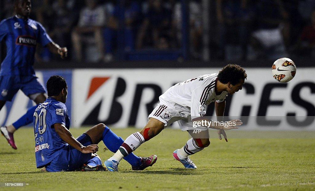 Wellington Nem of Brazil's Fluminense vies for the ball with Andre Rosales of Ecuador's Emelec during their Copa Libertadores football match at...
