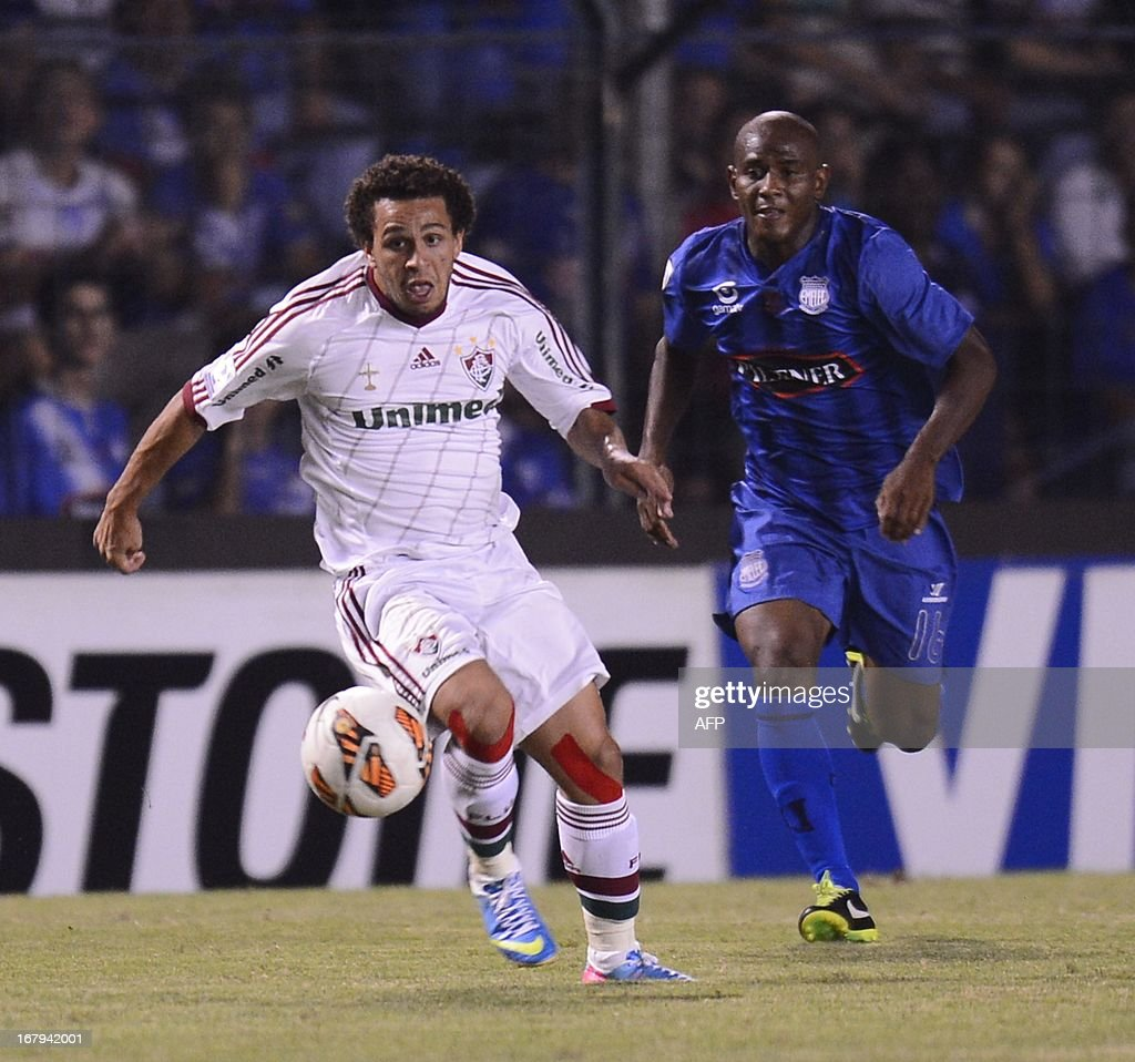 Wellington Nem of Brazil's Fluminense vies for the ball with Oscar Bagui of Ecuador's Emelec during their Copa Libertadores football match at George...