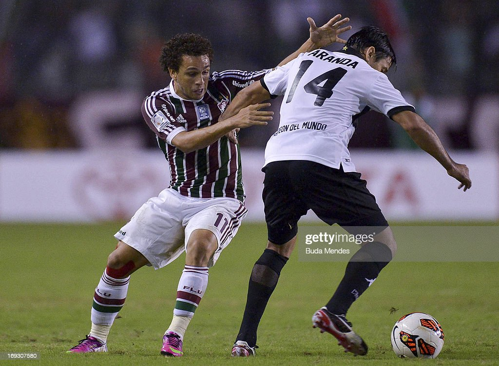 Wellington Nem of Fluminense fights for the ball during a match between Fluminense and Olimpia as part of the Copa Bridgestone Libertadores 2013 at...