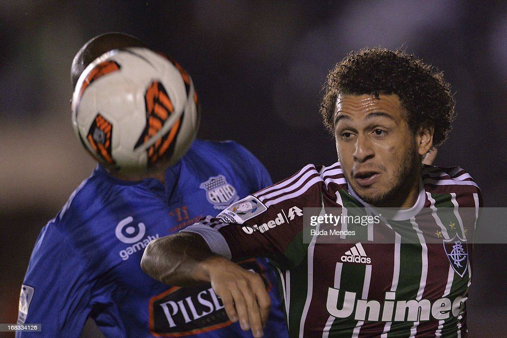 Wellington Nem of Fluminense fights for the ball during the match between Fluminense and Emelec as part of Libertadores Cup 2013 at Sao Januario...