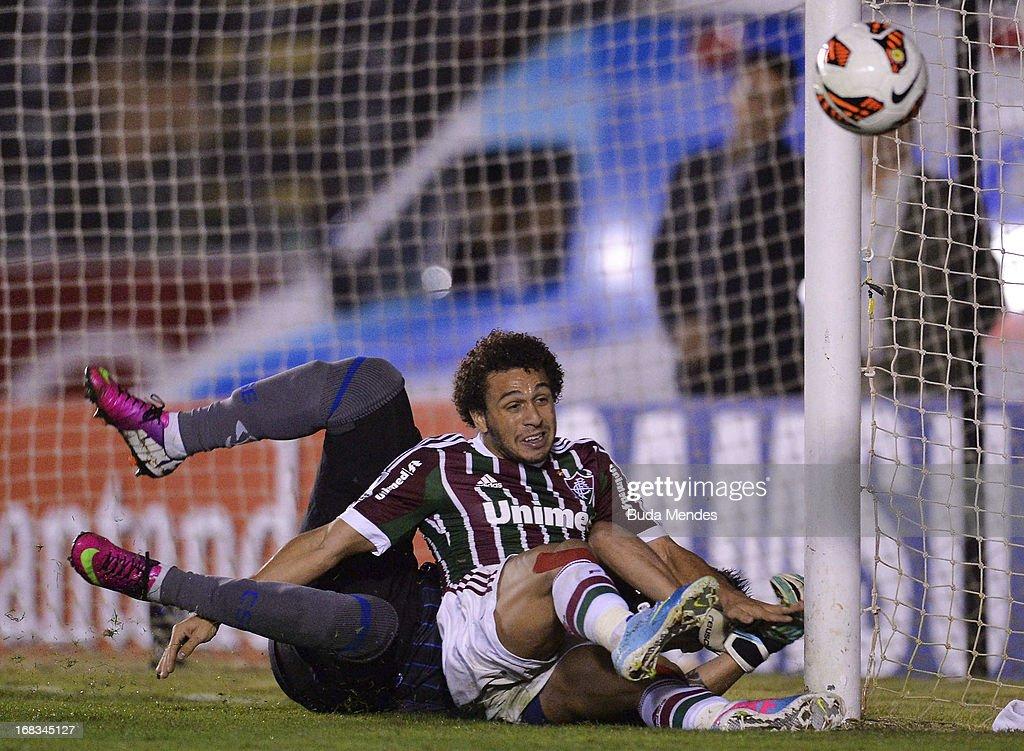 Wellington Nem of Fluminense fights for the ball with Goalkeeper Wilmer Fabian Zumba of Emelec during the match between Fluminense and Emelec as part...