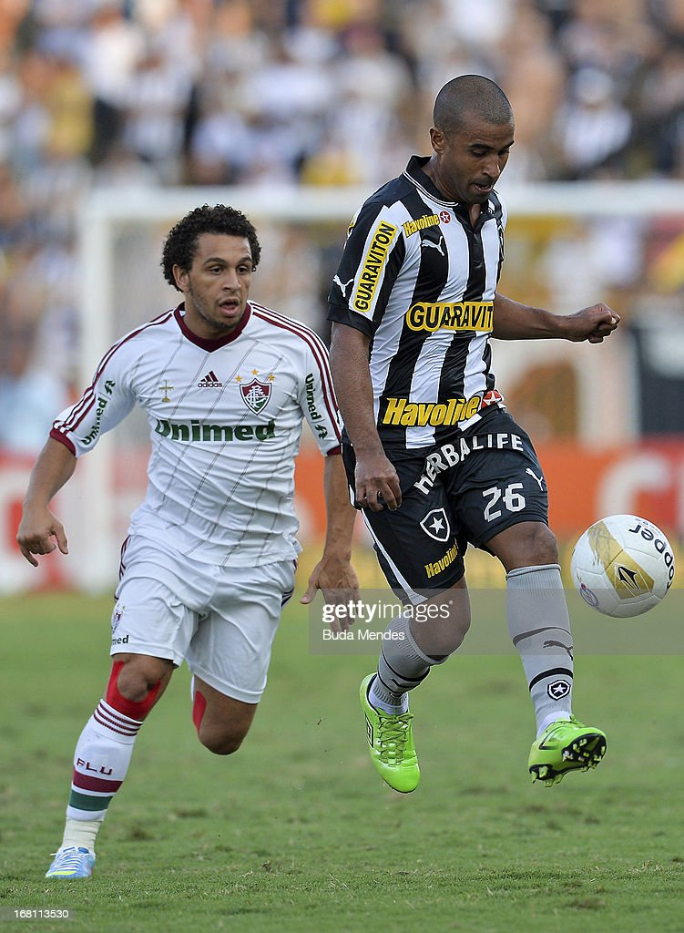 Wellington Nem of Fluminense fights for the ball with Julio Cesar of Botafogo during a match between Fluminense and Botafogo as part of Rio State...