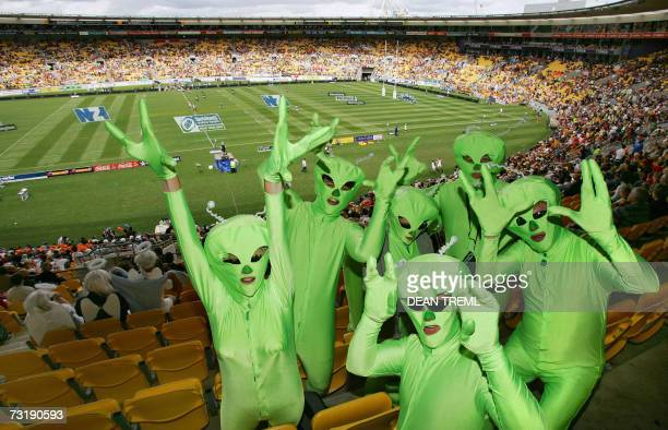 Rugby sevens fans dressed as aliens pose in the stands during day two of the third round of the IRB International Sevens at Westpac Stadium in...