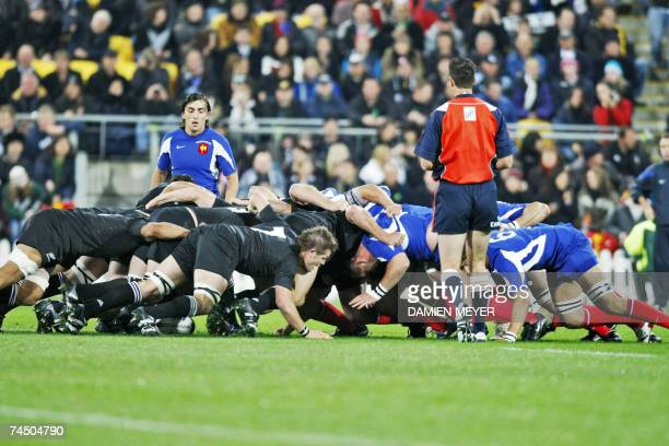 Scrum is pictured with France's scrum half Nicolas Durand during the match New Zealand vs France at Wellington stadium 09 June 2007 New Zealand...