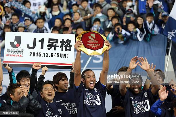 Wellington of Avispa Fukuoka celebrates promotion with the JLeague Play Offs Winners Shield Trophy during the J2 Promotion Play Off Final between...