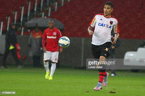 Wellington of Internacional battles for the ball against Paolo Guerrero of Flamengo during the match between Internacional and Flamengo as part of...